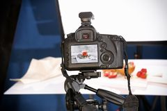 Professional camera on tripod. While shooting food Stock Photos