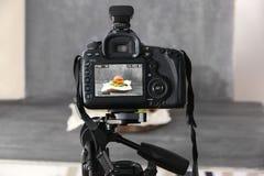 Professional camera on tripod. While shooting food Stock Photo