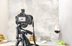 Professional camera on tripod. While shooting food Stock Image
