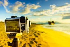 Camera on tripod and shipwreck Stock Photos