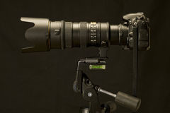 Professional Camera and Zoom Lens On Tripod Revised Stock Images