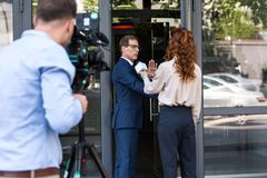 professional cameraman and news reporter with businessman stock photography