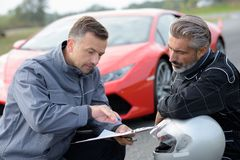 Professional car driver with coach royalty free stock photo