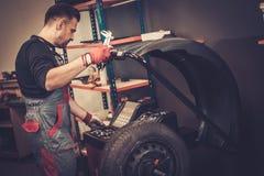 Professional car  mechanic balancing car wheel on balancer in au Stock Photo