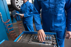 Free Professional Car Mechanic Standing Near Set With Tools Royalty Free Stock Images - 80992399