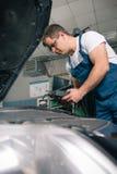 Professional car mechanic working Stock Image
