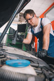 Professional car mechanic working Stock Images