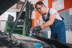 Professional car mechanic working Royalty Free Stock Photo