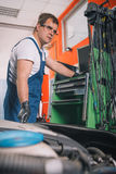 Professional car mechanic working Royalty Free Stock Images