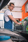 Professional car mechanic working Stock Photo