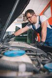 Professional car mechanic working Royalty Free Stock Photos