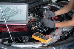 Car repair and maintenance. Performing engine diagnostics. Professional car mechanic working in auto repair service stock photos