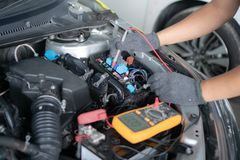 Car repair and maintenance. Performing engine diagnostics stock photo