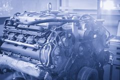 Professional car mechanic working in auto repair service. Petrol stock photo