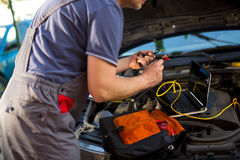 Professional car mechanic working in auto repair service Stock Image