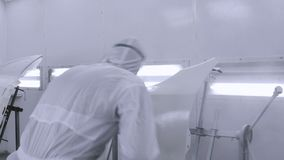A professional car painter is painting a body work stock video footage