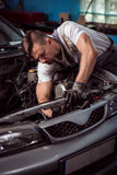 Professional car technician during labor Stock Photo