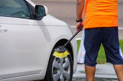 Professional car wash by hand with a big brush Stock Images