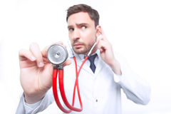 Professional cardiologist holding stethoscope Royalty Free Stock Image