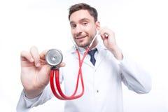 Professional cardiologist holding stethoscope Royalty Free Stock Photos