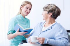 Professional carergiver and elderly patient Stock Photo