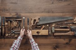 Carpenter holding tools stock image