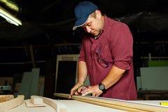Professional carpenter at work. Stock Photos