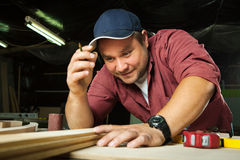 Professional carpenter at work. Stock Photo