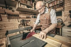 Woodworker cutting wood stock photos