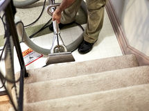 Professional Carpet Cleaner workin on the Stairs Stock Photo