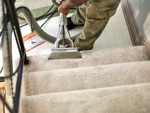 Professional Carpet Cleaner workin on the Stairs Stock Images
