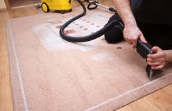 Professional carpet cleaning. With the use of special vacuum cleaner stock photos