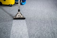 Free Professional Carpet Cleaning Service. Vacuum Cleaner Royalty Free Stock Photos - 212710388