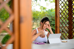 Professional casual woman working online with laptop outside Stock Photography