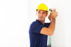Cctv technician camera. Professional cctv technician adjusting security camera angle stock photos