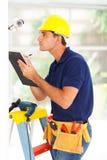 Cctv technician recording. Professional cctv technician recording camera serial number Royalty Free Stock Photography
