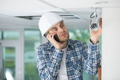 Professional cctv technician working. Man stock images