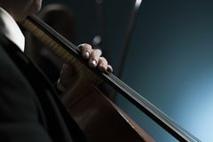 Professional cellist performing hands close up. Professional cellist performing on stage, hand close up, classical music concert royalty free stock image