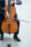 Professional cellist playing his instrument Royalty Free Stock Photo