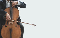 Professional cellist playing his instrument. Professional male cellist playing his cello, classical music solo performance stock images