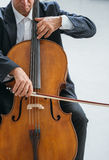 Professional cellist playing his instrument. Professional male cellist playing his cello, classical music solo performance stock photos