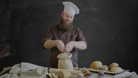 Chef checks the quality of the flour then crossed his hands and smiling looks at the camera stock video