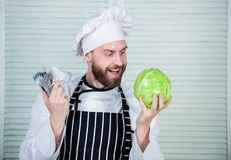 Professional chef cook in restaurant kitchen. vegetarian. Diet vitamin. culinary cuisine. vegetable transportation. man. Buy cabbage for dollars. mature man royalty free stock photo