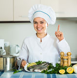 Professional chef cooking mackerel Royalty Free Stock Photos