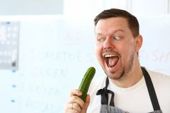 Professional Chef Eating Green Organic Cucumber royalty free stock images