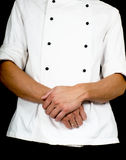 Professional chef with a hand gesture towards, wearing a chefs j Royalty Free Stock Photography