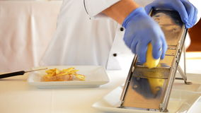 Professional chef hands cutting potatoes with knife and mandolin stock video footage
