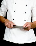 Professional chef holding a sharp cooking knife Royalty Free Stock Images