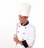 Professional chef holding a white blank placard Royalty Free Stock Images