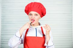 Professional chef in kitchen. Cuisine. woman in cook hat and apron. happy woman cooking healthy food by recipe royalty free stock photos